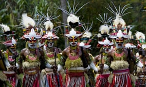 Men perform a traditional dance in Papua New Guinea.