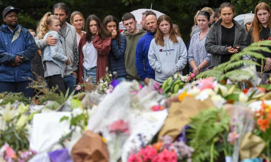 People gather to mourn for the victims of the attacks on two mosques in Christchurch