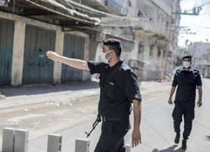 Palestinian Hamas policemen stop vehicles during a 48-hour lockdown imposed following the discovery of the first coronavirus cases in the Gaza Strip.