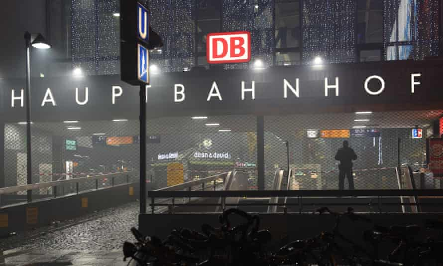 Police officers guard the entrance to the closed central station in Munich.