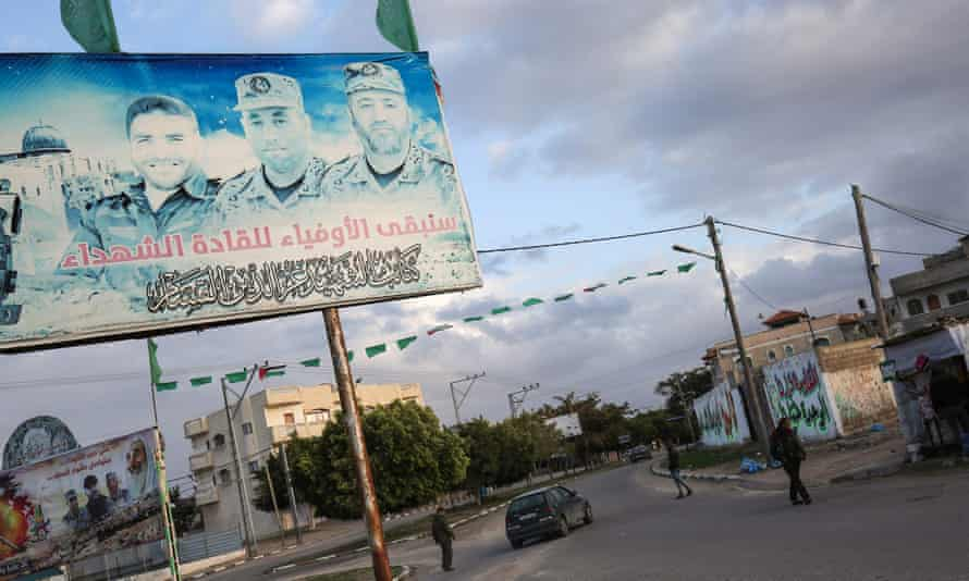 A billboard bearing the portraits of Hamas commanders whose deaths have been linked to information supplied by Ahmad Said Barhoum.