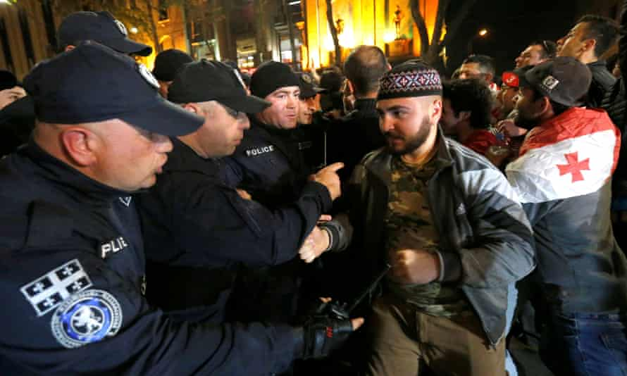 Police officers scuffle with counter-protesters during the rally against the government's anti-drug policy in Tbilisi on 13 May.