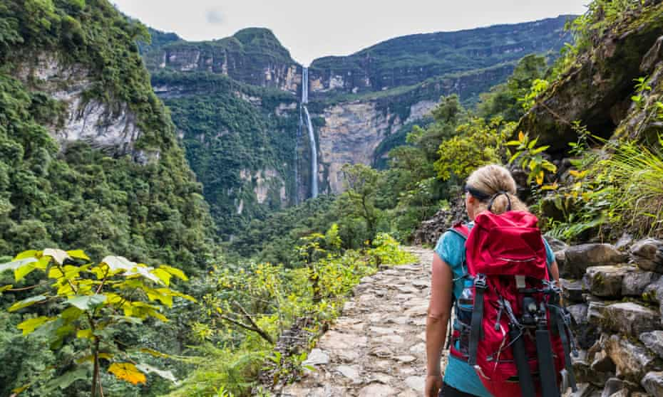 Tourist on hiking trail looking at Gocta waterfall