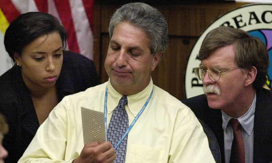 Attorney Nicole Pollard, Judge Charles Burton and attorney John Bolton review questionable ballots for the 2000 presidential election in Florida.