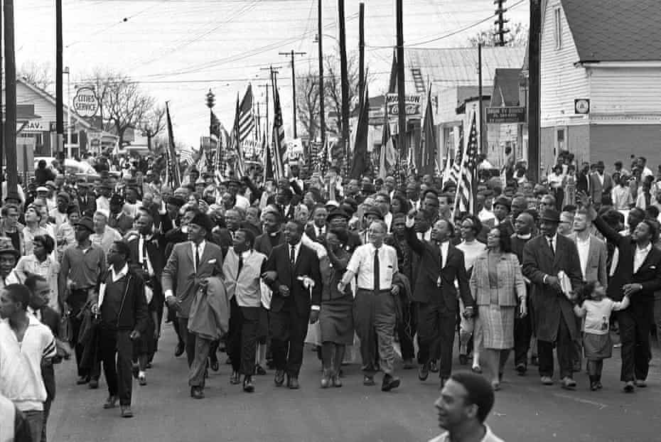 Martin Luther King, center, leads marchers across the Alabama river during the march to the state capitol at Montgomery.