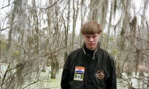 An undated handout photo provided by Berkeley County of Dylann Roof. He told a childhood friend that 'blacks were taking over the world'.