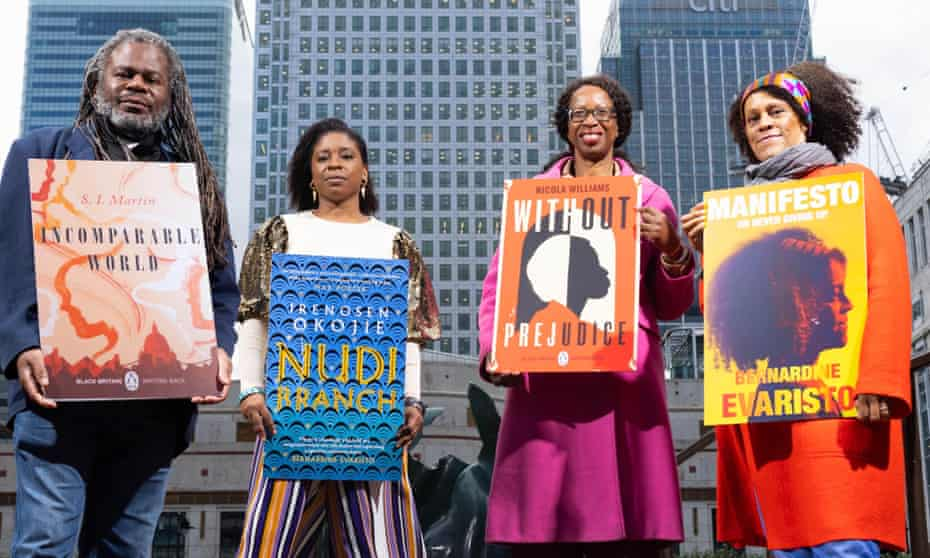 (From left) SI Martin, Irenosen Okojie, Nicola Williams and Bernardine Evaristo unveil their contributions to the Short Story Stations project at Canary Wharf in London