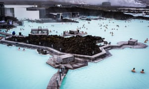 People bathing in The Blue Lagoon, a geothermal bath resort in Iceland