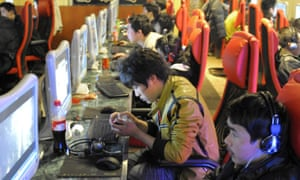 Young men play online games at an internet cafe in Beijing in 2010. Due to economic and cultural reasons, home consoles are still a hard sell in China.