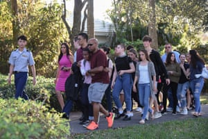 Students react following the shooting at Marjory Stoneman Douglas high school.