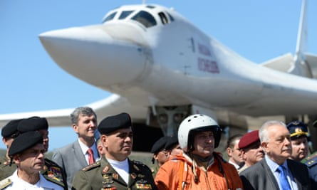 The Venezuelan defence minister, Vladimir Padrino López, second left, is pictured after the arrival of two Russian Tupolev Tu-160 strategic long-range heavy supersonic bomber aircrafts in Caracas.