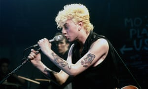 The Stray Cats on stage at the Markthalle in Hamburg in 1981, with Brian Setzer singing and Slim Jim Phantom in the background.