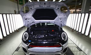 A Mini receives its final inspection before leaving the assembly line at the BMW Mini car plant in Oxford.