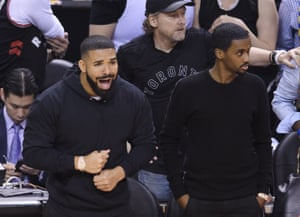 Drake yells courtside as the Toronto Raptors take on the Golden State Warriors in basketball's NBA finals