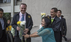 Andy Hall receiving flowers outside the Bangkok South Criminal Court in January 2016.