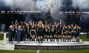 Richie McCaw lifts the trophy after leading the All Blacks to a deserved victory.
