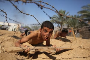 A Palestinian boy takes part in a military-style summer camp being held by the Islamic Jihad movement in Khan Younes