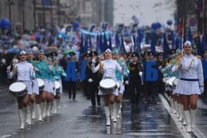 Vladivostok, Russia. A marching band parades through Svetlanskaya Street marking International Workers' Day