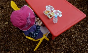 A young child eats her morning tea at a preschool in Canberra