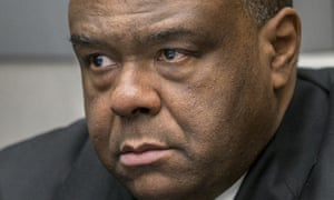 Jean-Pierre Bemba takes his seat in court room on Monday. The former Congolese vice-president was arrested in Belgium in 2008.
