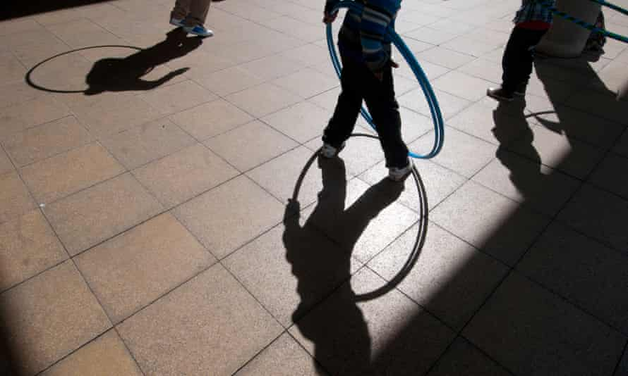 Shadow of children playing with hula hoops