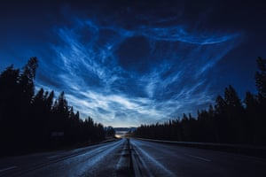 The Road Back HomeRuslan Merzlyakov (Latvia). Noctilucent clouds stretch across the Swedish sky illuminating a motorcyclist's ride home in this dramatic display. Noctilucent clouds are the highest clouds in the Earth's atmosphere and form above 200,000 ft. Thought to be formed of ice crystals, the clouds occasionally become visible at twilight when the Sun is below the horizon and illuminates them