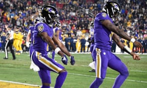 Baltimore Ravens wide receiver Marquise Brown (left) and quarterback Lamar Jackson celebrate their first quarter touchdown.