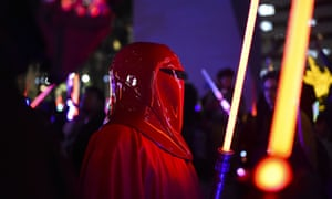 A Star Wars fan dressed as an Imperial Guard attends Lightsaber Battle LA in Pershing Square.