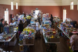 Local residents stock up on supplies at the Quaama Hall in Quaama.