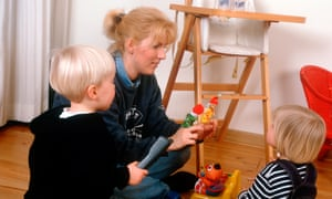 woman playing with two young children