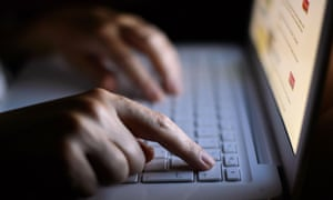 Someone using a laptop keyboard.