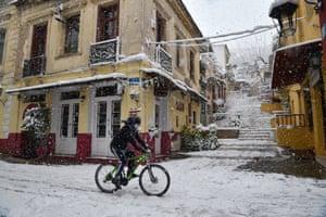 A cyclist rides through Plaka.
