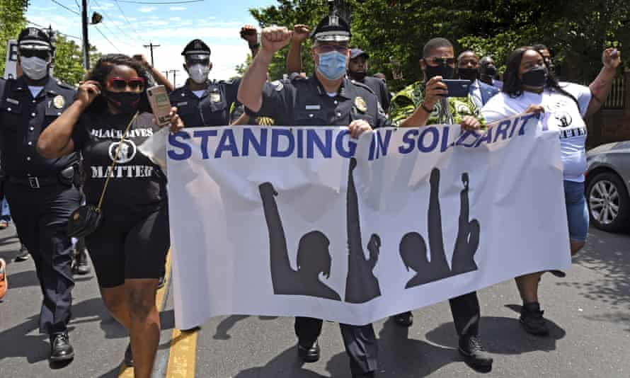 Joe Wysocki, metro police chief of Camden county, raises a fist while marching with Camden residents and activists in Camden, New Jersey, on Saturday to protest about the death of George Floyd.