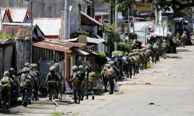 Philippine Marines advance their positions as more soldiers reinforce to fight the Maute group in Marawi City in southern Philippines.