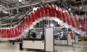 A worker watches an automated garment transfer system at John Lewis's distribution centre in Milton Keynes.