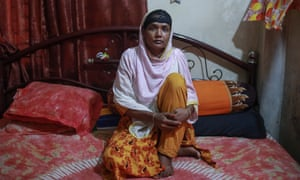 Akhi Akter, 30, at home in Ashulia, says she hasn't been paid for two months she worked before she fell ill with Covid symptoms.
