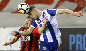 Bournemouth's Ryan Fraser is beaten to the ball by Wigan Athletic's Ryan Colclough during their FA Cup third-round replay.
