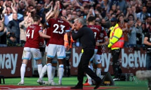 West Ham's Marko Arnautovic celebrates scoring his side's third goal while Manchester United manager Jose Mourinho cuts a frustrated figure.