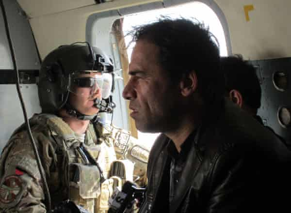 Agence France-Presse photographer Shah Marai sits in a helicopter with a member of the International Security Assistance Force while on assignment in Afghanistan in 2013.
