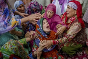 Srinagar, KashmirRuksana Nazir, center, is comforted during the funeral of her husband Nazir Ahmed Wani in Srinagar, Indian controlled Kashmir, Friday, Oct. 5, 2018. Suspected rebels on Friday shot and killed two activists, which included Wani, affiliated with a pro-India Kashmiri political group in the disputed region's main city, officials said.