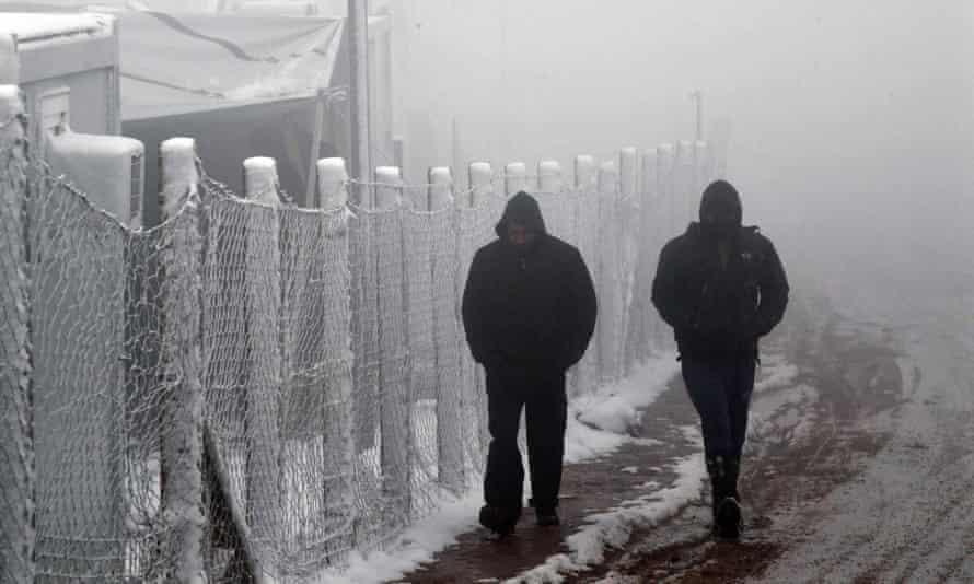 Migrants near border fence