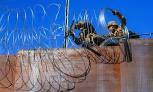 US troops install barbed wire on the border with Mexico as seen from Colonia Libertad in Tijuana, Mexico, on Monday.