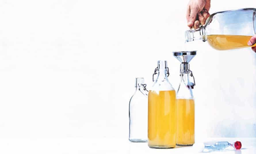 Mead being decanted into glass bottles