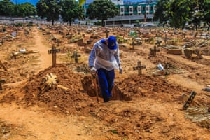 Rio de Janeiro, BrazilA worker digs graves at the St Francisco Xavier cemetery