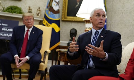 President Donald Trump listens as Vice-President Mike Pence speaks about the coronavirus response in the Oval Office of the White House last week.