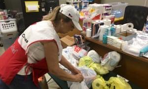 Liz Bemtivegna assembles kits of necessities at a Red Cross shelter.