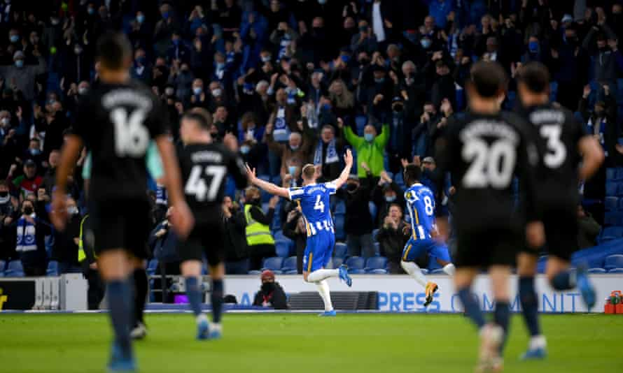 Adam Webster celebrates his equaliser for Brighton as fans raised the roof against Manchester City.
