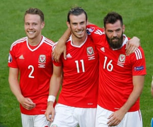 Chris Gunter, Gareth Bale and Joe Ledley celebrate after the match.