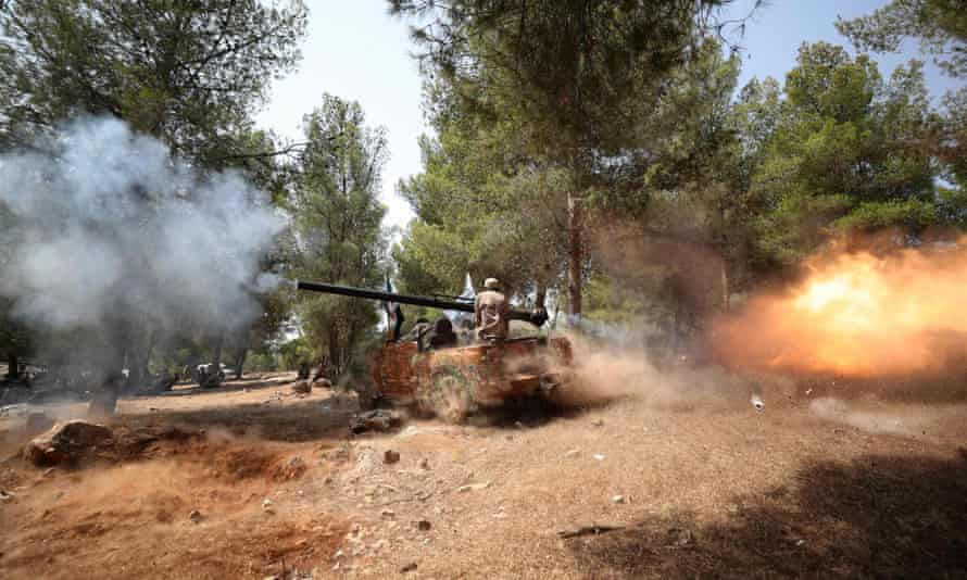Turkish-backed forces in the Syrian town of al-Ghazawiya, near Afrin in the rebel-held northern countryside of Aleppo province, on 28 July.