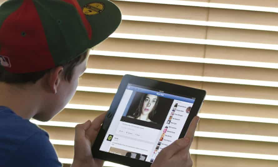 Boy using Facebook